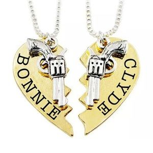 Brand new in package Gold Bonnie and Clyde set